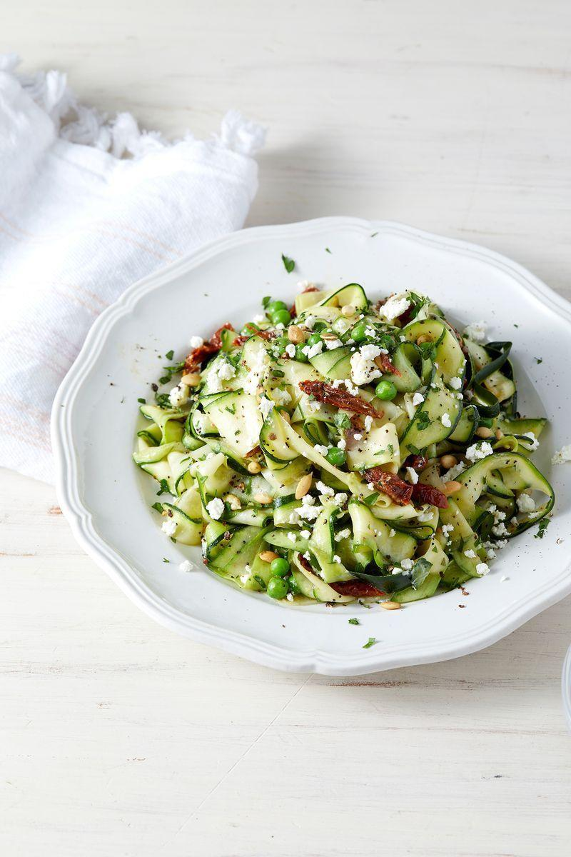 """<p>This <a href=""""https://www.delish.com/uk/cooking/recipes/g28961915/courgette-recipes/"""" rel=""""nofollow noopener"""" target=""""_blank"""" data-ylk=""""slk:courgette"""" class=""""link rapid-noclick-resp"""">courgette</a> salad is so easy to throw together, and best of all, there's no cooking required! Yep, those courgette ribbons are served raw, tossed with sundried toms and goat's cheese, and a <a href=""""https://www.delish.com/uk/cooking/recipes/a29771350/pumpkin-spice-poke-cake-recipe/"""" rel=""""nofollow noopener"""" target=""""_blank"""" data-ylk=""""slk:pumpkin"""" class=""""link rapid-noclick-resp"""">pumpkin</a> seed dressing which although optional is a MUST in our opinion.</p><p>Get the <a href=""""https://www.delish.com/uk/cooking/recipes/a29840065/courgette-salad/"""" rel=""""nofollow noopener"""" target=""""_blank"""" data-ylk=""""slk:Courgette Salad"""" class=""""link rapid-noclick-resp"""">Courgette Salad</a> recipe.</p>"""