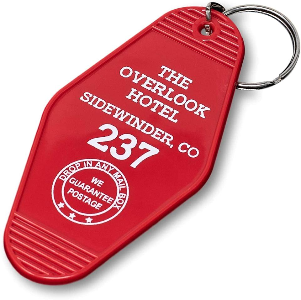 """<h2>The Shining Keychain<br></h2><br>All keys and no fob makes Jack a hot mess. <br><br><strong>Chillkat</strong> Vintage Hotel Motel Keychain, $, available at <a href=""""https://www.amazon.com/Vintage-Hotel-Motel-Keychain-Overlook/dp/B07RQW1PSJ"""" rel=""""nofollow noopener"""" target=""""_blank"""" data-ylk=""""slk:Amazon"""" class=""""link rapid-noclick-resp"""">Amazon</a>"""