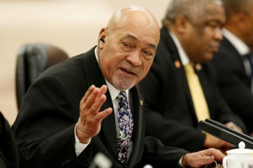 Suriname's President Desi Bouterse remains confident his party will hold onto power, but the opposition accuses it of corruption and over-spending