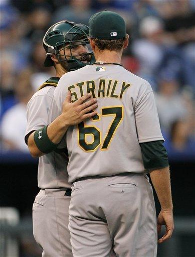 Oakland Athletics catcher Derek Norris, left, talks with pitcher Dan Straily (67) after loading the bases in the second inning against the Kansas City Royals in Kansas City, Mo., Thursday, Aug. 16, 2012. (AP Photo/Colin E. Braley)