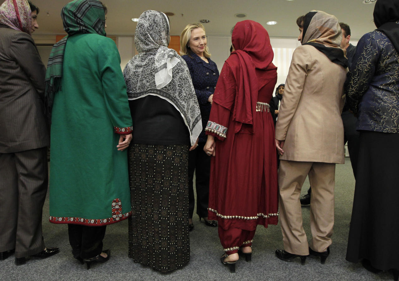 U.S. Secretary of State Hillary Rodham Clinton, center, meets with delegates from an Afghan women's civil society during an international conference on the future of Afghanistan, in Bonn, Germany, Monday, Dec. 5, 2011. Representatives of more than 90 countries and organizations are gathering to discuss the future of Afghanistan after the eventual withdrawal of foreign military forces. (AP Photo/J. Scott Applewhite, Pool)