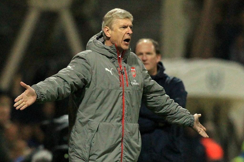 Arsenal's French manager Arsene Wenger gestures on the touchline during the English FA Cup third round football match between Preston North End and Arsenal at Deepdale in north west England on January 7, 2017 (AFP Photo/Lindsey PARNABY)