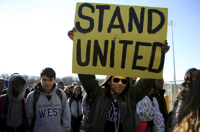 <p>Freshman Kennedi Lawson, 14, carries a sign as student walkout at Cherry Hill West High School in remembrance of those killed in the Parkland, Fla., shooting in Cherry Hill, N.J., on Wednesday, March 14, 2018. ( Photo: David Maialetti /The Philadelphia Inquirer via AP) </p>