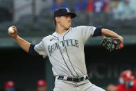 Seattle Mariners pitcher Chris Flexen throws to a Texas Rangers batter during the first inning of a baseball game Friday, May 7, 2021, in Arlington, Texas. (AP Photo/Richard W. Rodriguez)