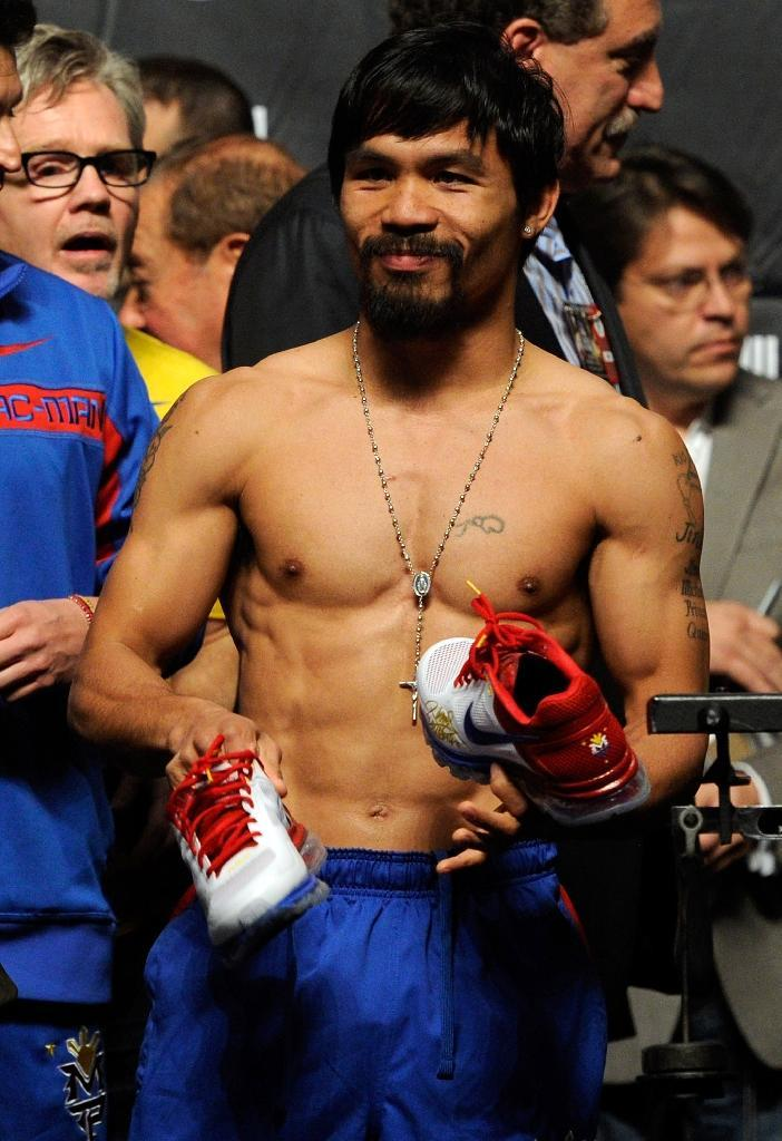 "Nike, Manny Pacquiao's major global sponsor, immediately cancelled its endorsement deal with him, describing his gay slurs as ""abhorrent"" (AFP Photo/Ethan Miller)"