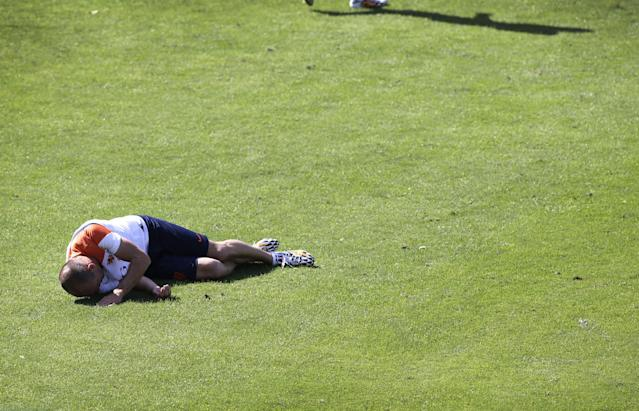 Arjen Robben, lays on the ground after being tackled by Bruno Martins Indi, from the Netherlands soccer team during a training session in Rio de Janeiro, Brazil, Sunday June 8, 2014. Arjen Robben has reacted angrily to a tough challenge from Netherlands teammate Bruno Martins Indi during a World Cup training session at their base in Rio. The Netherlands play in group B of the 2014 soccer World Cup. (AP Photo/Wong Maye-E)
