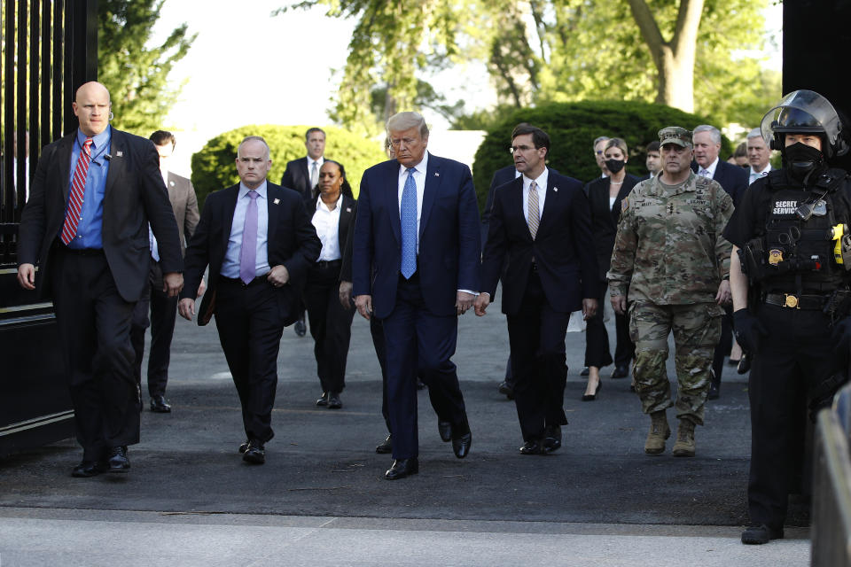 President Donald Trump walks from the White House to visit St. John's Church across Lafayette Park Monday, June 1, 2020, in Washington. (AP Photo/Patrick Semansky)