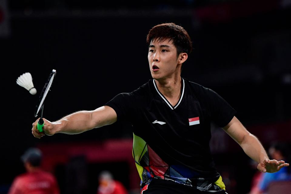 Singapore shuttler Loh Kean Yew in action against the Refugee Olympic Team's Aram Mahmoud in their men's singles badminton group stage match at the Tokyo Olympics.