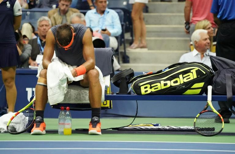 Feel the pain: Rafael Nadal courtside suffering from a right knee injury