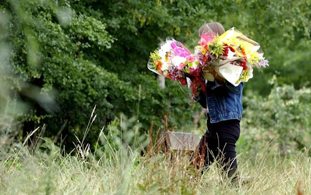 Flowers being delivered to the scene in Ashford, Kent, after Amanda Champion was killed (Picture: PA)