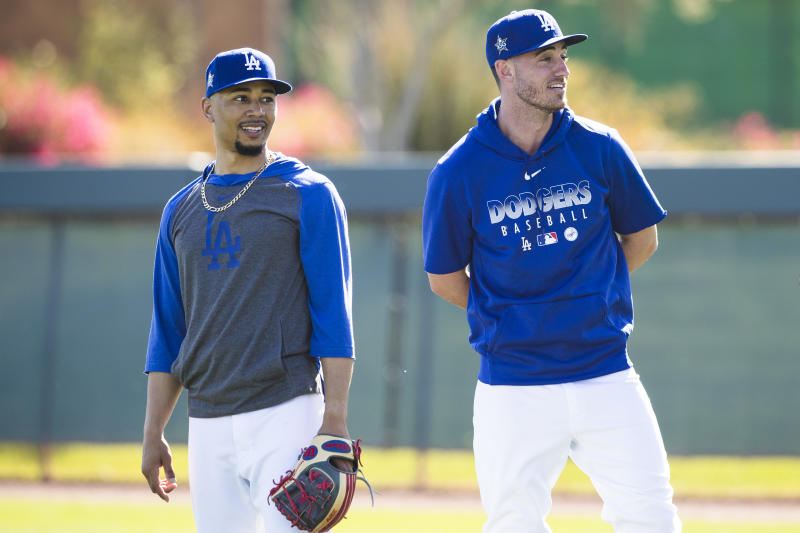 GLENDALE, AZ - FEBRUARY 20: Mookie Betts #50 and Cody Bellinger #35 of the Los Angeles Dodgers look on during a workout after Photo Day on Thursday, February 20, 2020 at Camelback Ranch in Glendale, Arizona. (Photo by Adam Glanzman/MLB Photos via Getty Images)
