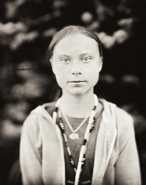 This Oct. 8, 2019 photo provided by Shane Balkowitsch shows climate activist Greta Thunberg visiting the Standing Rock Sioux Reservation in Fort Yates, N.D. Thunberg accepted the photographer's request to pose for the photo using an old technique that involves wetting glass plates with various chemicals before making an exposure. The resulting photographs are being archived at the Library of Congress in Washington and the Swedish History Museum in Stockholm. (Shane Balkowitsch via AP)