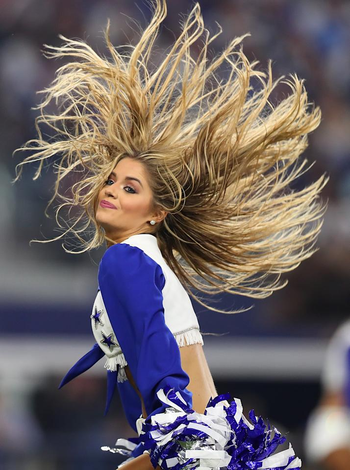 <p>A Dallas Cowboys Cheerleader performs during a game against the New York Giants at AT&T Stadium on September 10, 2017 in Arlington, Texas. (Photo by Tom Pennington/Getty Images) </p>