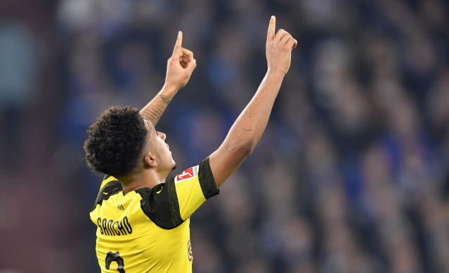 Dortmund's Jadon Sancho celebrates after scoring his side's second goal against Schalke goalkeeper Ralf Faehrmann during the German Bundesliga soccer match between FC Schalke 04 and Borussia Dortmund at the Arena in Gelsenkirchen, Germany, Saturday, Dec. 8, 2018. (AP Photo/Martin Meissner)