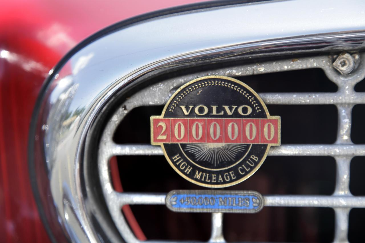 A two million mile badge adorns Irv Gordon's Volvo P1800 in Babylon, N.Y., Monday, July 2, 2012. Gordon's car already holds the world record for the highest recorded milage on a car and he is less than 40,000 miles away from passing three million miles on the Volvo. (AP Photo/Seth Wenig)