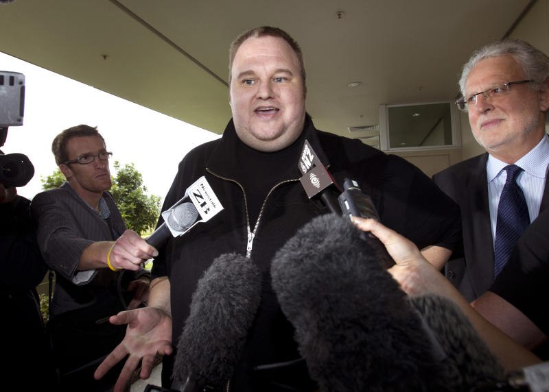 """FILE - In this Feb. 22, 2012 file photo, Kim Dotcom, the founder of the file-sharing website Megaupload, comments after he was granted bail and released in Auckland, New Zealand. Indicted Megaupload founder Kim Dotcom has launched a new file-sharing website in a defiant move against the U.S. prosecutors who accuse him of facilitating massive online piracy. The colorful entrepreneur unveiled the """"Mega"""" site ahead of a lavish gala and press conference planned at his New Zealand mansion on Sunday night, Jan. 20, 2013. (AP Photo/New Zealand Herald, Brett Phibbs, File) NEW ZEALAND OUT, AUSTRALIA OUT"""