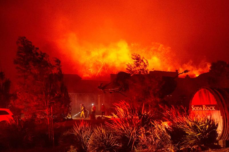 Firefighters have had to contend with powerful winds with at least one gust clocked at 102 miles per hour: AFP via Getty Images
