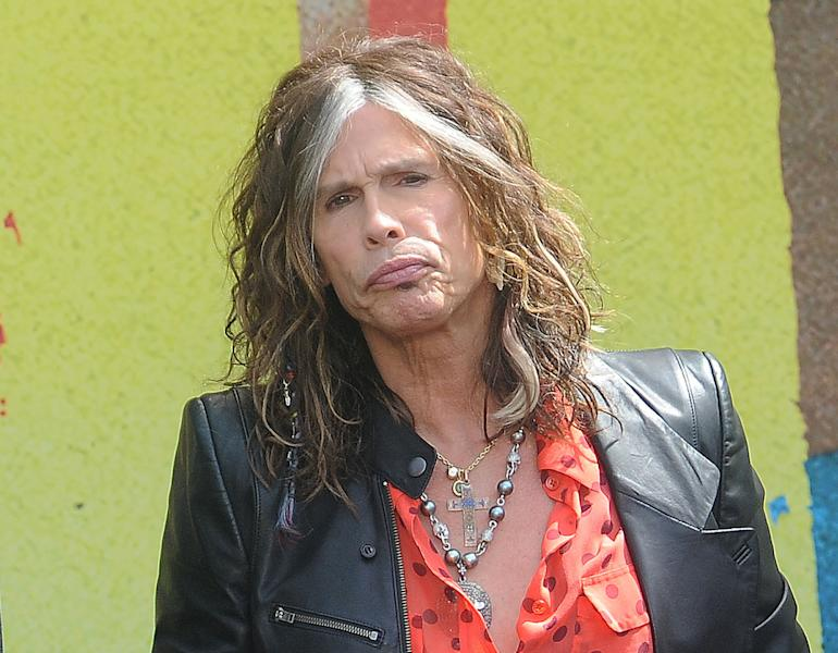 "FILE - This March 28, 2012 file photo shows Steven Tyler speaking at the Aerosmith news conference announcing the 2012 Global Warming Tour in Los Angeles. Tyler announced Thursday, July 12, 2012 that he will not be returning as a judge on the singing competition series ""American Idol."" Tyler served as a judge with singer/actress Jennifer Lopez and Randy Jackson on the 10th and 11th season of the series. (AP Photo/Katy Winn, file)"