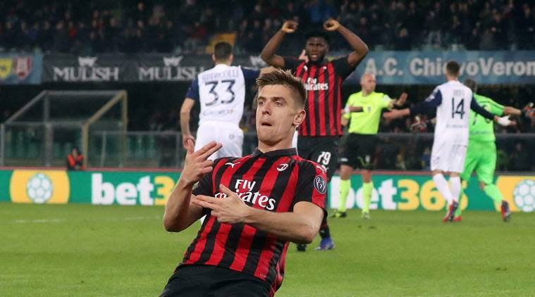 Milan's Krzysztof Piatek celebrates after scoring a goal during the Italian Serie A soccer match between AC Chievo Verona and AC Milan at the Marcantonio Bentegodi stadium in Verona, Italy