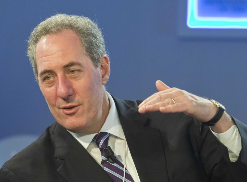U.S. Trade Representative Michael Froman, right, gestures as he talks with EU Trade Commissioner Karel De Gucht, prior to a session at the World Economic Forum in Davos, Switzerland, Saturday, Jan. 25, 2014. Global leaders argued Friday that efforts to eradicate poverty must be linked to climate change, saying that rising temperatures will have widespread effects on everything from food supplies to education. (AP Photo/Michel Euler)