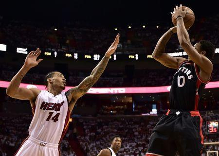 May 7, 2016; Miami, FL, USA; Toronto Raptors guard DeMar DeRozan (10) shoots over Miami Heat forward Gerald Green (14) during the first quarter in game three of the second round of the NBA Playoffs at American Airlines Arena. Mandatory Credit: Steve Mitchell-USA TODAY Sports / Reuters Picture Supplied by Action Images