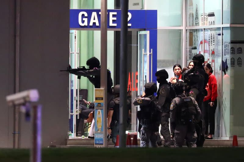 Thailand security forces enter in a shopping mall as they chase a shooter hidden in after a mass shooting in front of the Terminal 21, in Nakhon Ratchasima, Thailand