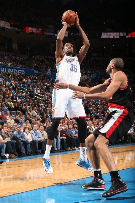 OKLAHOMA CITY, OK - JANUARY 21: Kevin Durant #35 of the Oklahoma City Thunder taking a shot during a game against the Portland Trailblazers on January 21, 2014 at the Chesapeake Energy Arena in Oklahoma City, Oklahoma. (Photo by Layne Murdoch/NBAE via Getty Images)