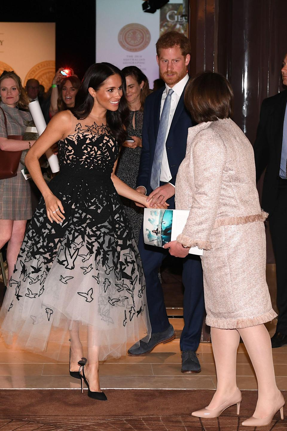 <p>The Duchess of Sussex saved her greatest look of the royal tour until October 26 for the Australian Geographic Society Gala Awards at the Shangri-La Hotel in Sydney. The cold-shoulder tulle gown is from Oscar de la Renta's pre-AW18 collection and she finished the Hollywood-worthy look with soft waves and her go-to £571 Tabitha Simmons shoes. <em>[Photo: Getty]</em> </p>