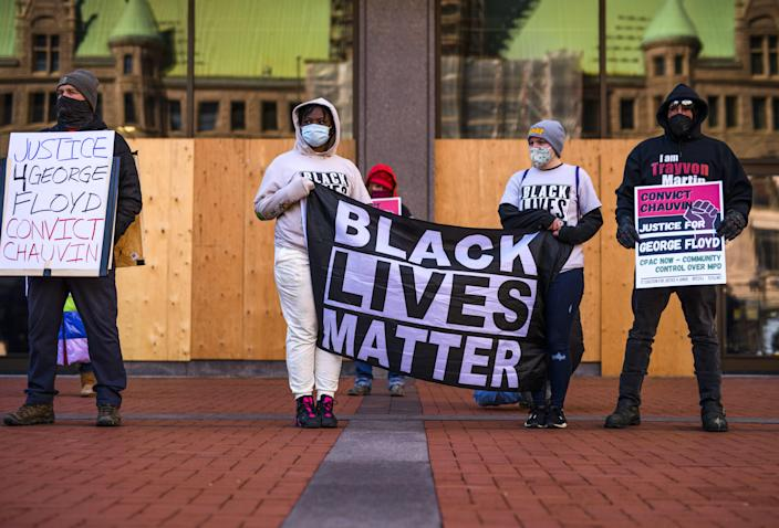 <p>Black Lives Matter protesters in Minneapolis, ahead of a trial press conference  </p> (Getty)