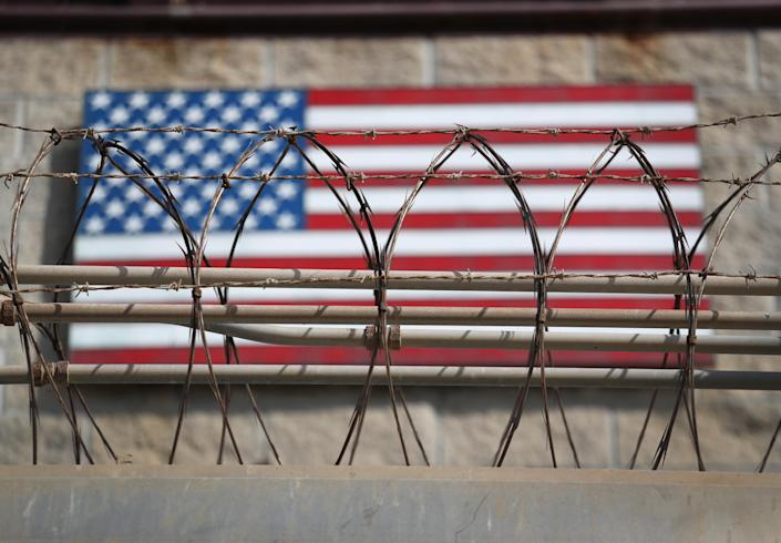 "GUANTANAMO BAY, CUBA - OCTOBER 22: (EDITORS NOTE: Image has been reviewed by the U.S. Military prior to transmission.) Razor wire lines the fence of the ""Gitmo"" maximum security detention center on October 22, 2016 at the U.S. Naval Station at Guantanamo Bay, Cuba. The U.S. military's Joint Task Force Guantanamo is still holding 60 detainees at the prison, down from a previous total of 780. On his second day in office in 2008 President Obama issued an executive order to close the prison, which has failed because of political opposition in the U.S. (Photo by John Moore/Getty Images)"