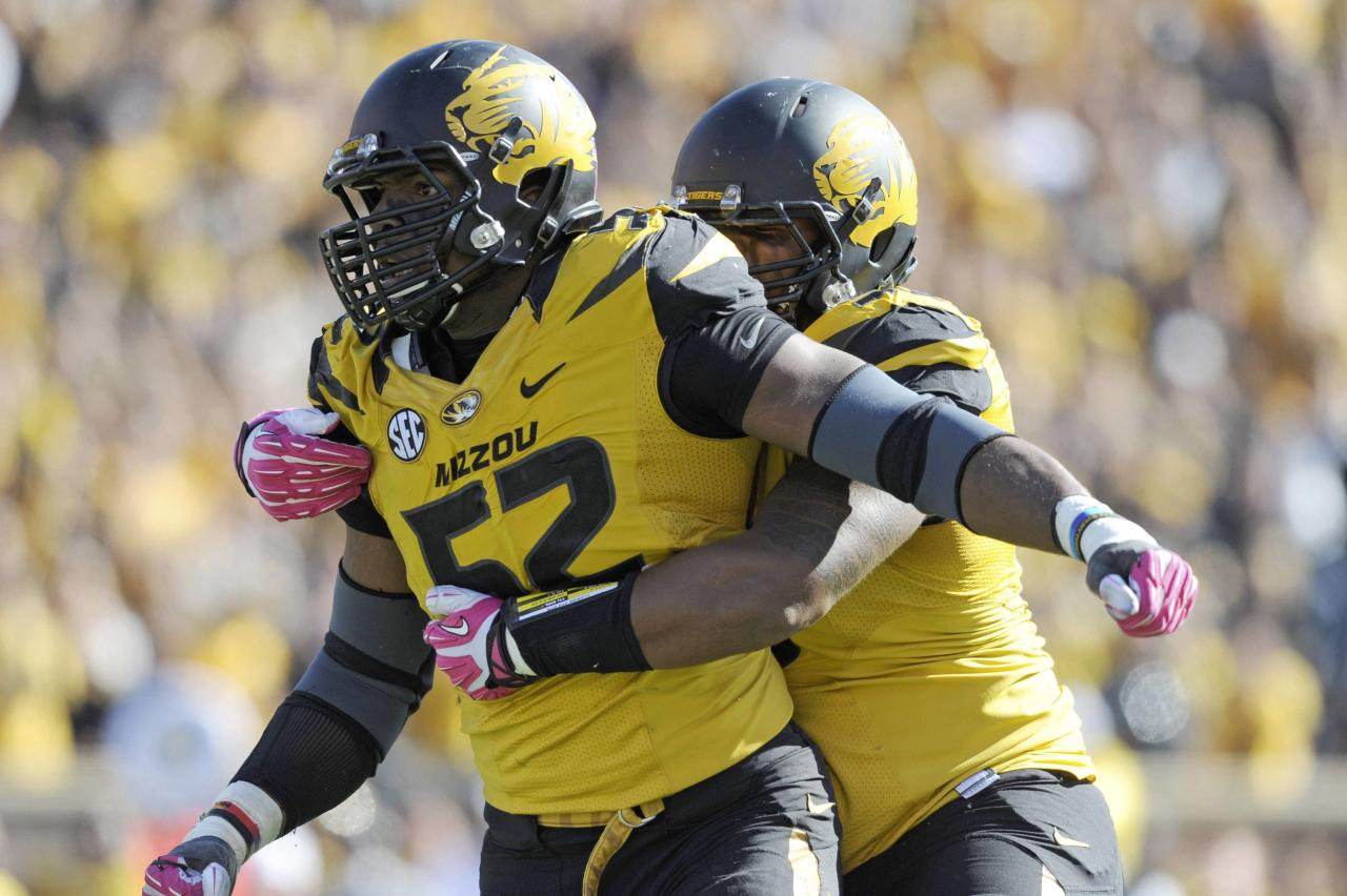 Missouri Tigers defensive lineman Michael Sam (52) is congratulated by defensive lineman Lucas Vincent (96) after sacking Florida Gators quarterback Tyler Murphy (not pictured) during the second half at Faurot Field in Columbia, Missouri in this file photo from October 19, 2013. According to media reports, Sam, who was the Southeastern Conference defense player of the year, announced publicly he was gay February 9, 2014, paving the way from him to perhaps be the NFL's first openly gay player. Mandatory Credit: Denny Medley-USA TODAY Sports (UNITED STATES)