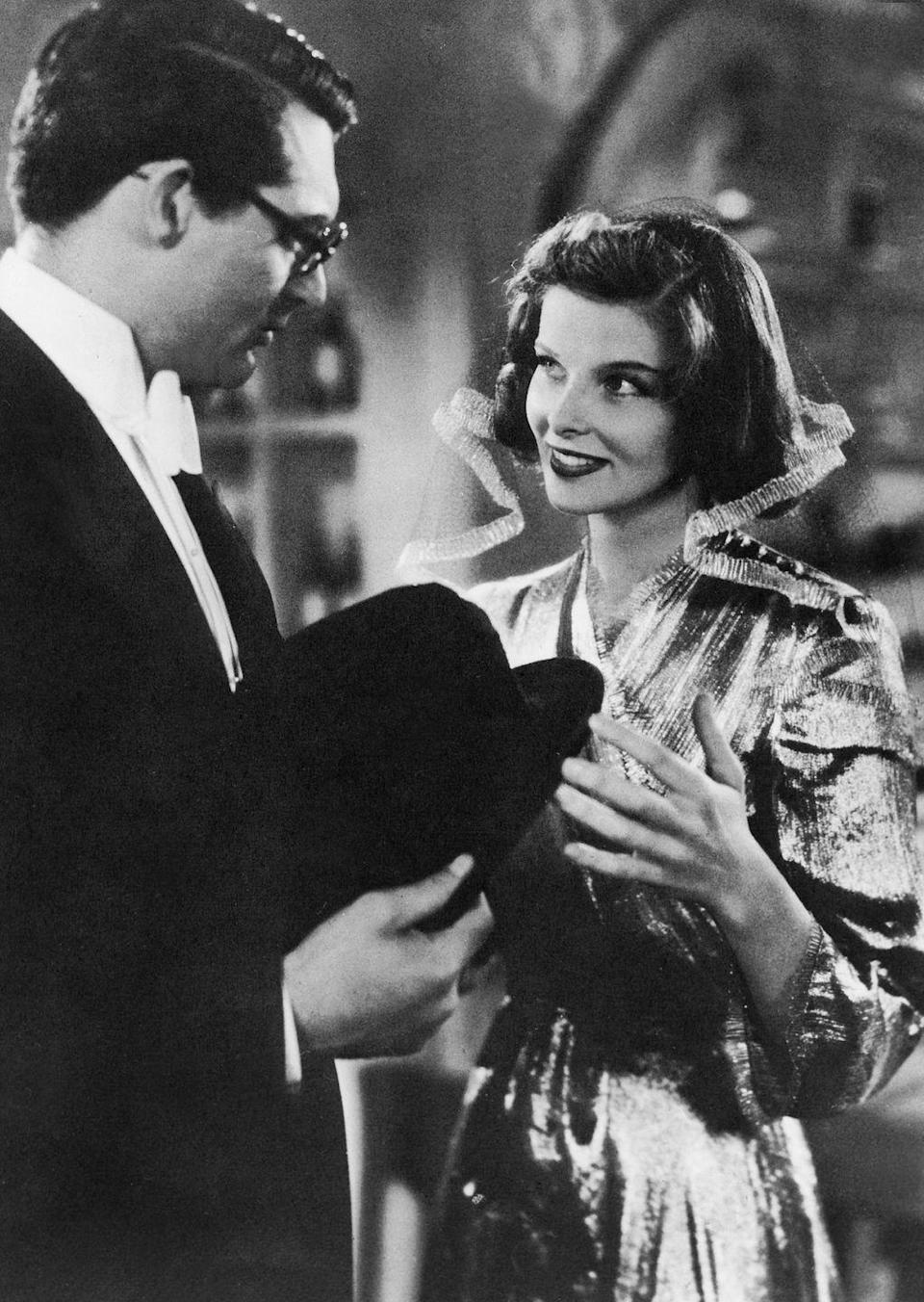 <p>In a movie that costars Katharine Hepburn and a pet leopard, it's no surprise the star boldly opted for a showstopping gold lamé floor-length gown. She topped off the look with a sheer veil with gold borders that'll forever be associated with <em>Bringing Up Baby</em>. </p>