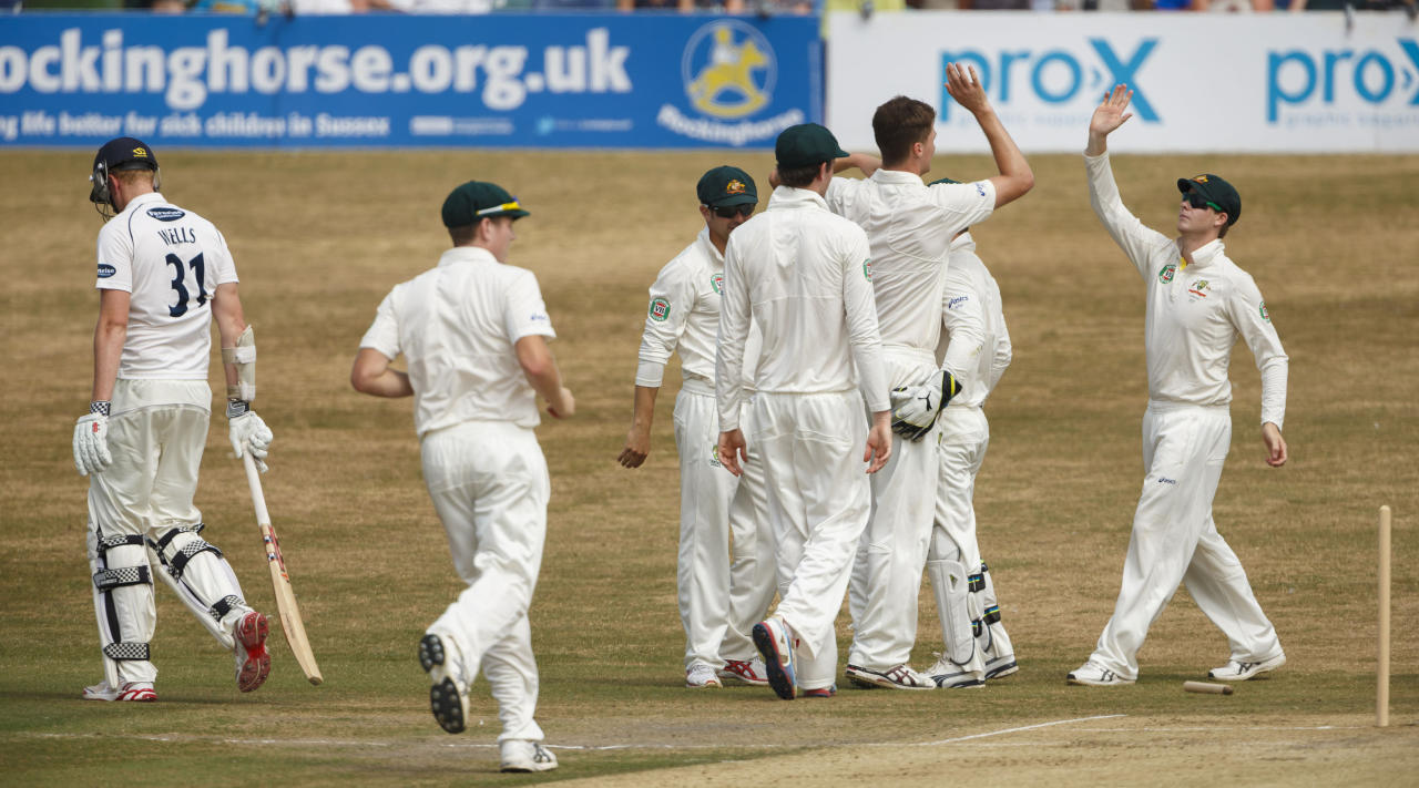 Sussex's Luke Wells walks after being bowled by Australia's Jackson Bird (second from right) during day two of the international tour match at the BrightonandHoveJobs.com County Cricket Ground, Hove.
