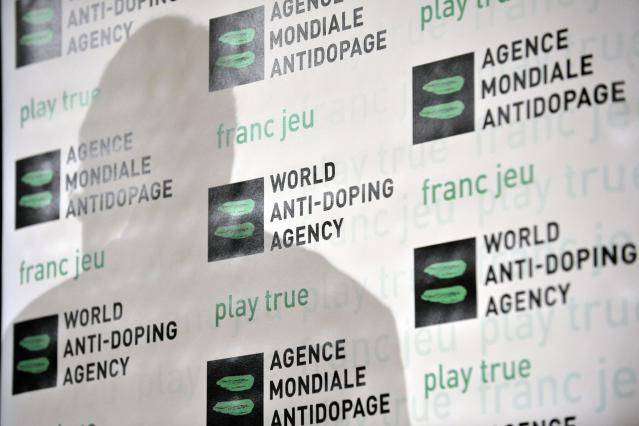 """FILE - A Tuesday, Feb. 24, 2009 photo from files showing the shadow of Australian John Fahey, President of the World Anti-Doping Agency, WADA, during a WADA Media Symposium at the Olympic Museum in Lausanne, Switzerland. FIFA's medical chief, Michel D'Hooghe, says he is """"really not happy"""" with drug-testing plans for the World Cup in Brazil, because samples taken from players must be flown across the Atlantic to a laboratory in Switzerland for analysis, possibly slowing results. FIFA had to turn to the lab in Lausanne because the Brazilian facility that was expected to analyze World Cup samples repeatedly failed to comply with World Anti-Doping Agency standards and so lost its authority to do testing.(AP Photo/Keystone, Laurent Gillieron, File)"""