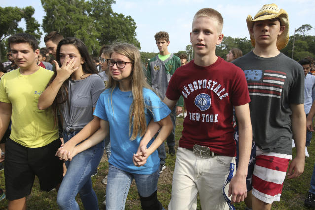 <p>Students are led out of Forest High School after a shooting at the school on Friday, April 20, 2018 in Ocala, Fla. (Photo: Bruce Ackerman/Star-Banner via AP) </p>