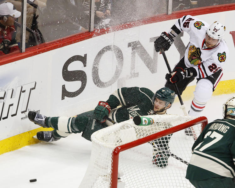 Chicago Blackhawks' Viktor Stalberg (25) takes down Minnesota Wild's Marco Scandella in the first period of Game 3 of an NHL hockey Stanley Cup playoff series Sunday, May 5, 2013 in St. Paul, Minn.(AP Photo/Andy King)