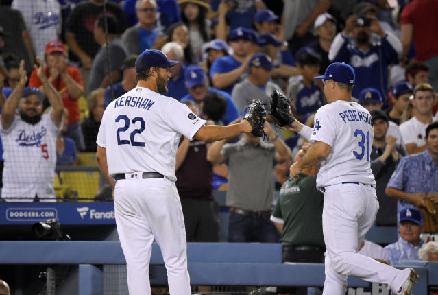 Los Angeles Dodgers right fielder Joc Pederson, right, is congratulated by starting pitcher Clayton Kershaw after making a catch on a ball hit by St. Louis Cardinals' Andrew Knizner during the seventh inning of a baseball game Tuesday, Aug. 6, 2019, in Los Angeles. (AP Photo/Mark J. Terrill)