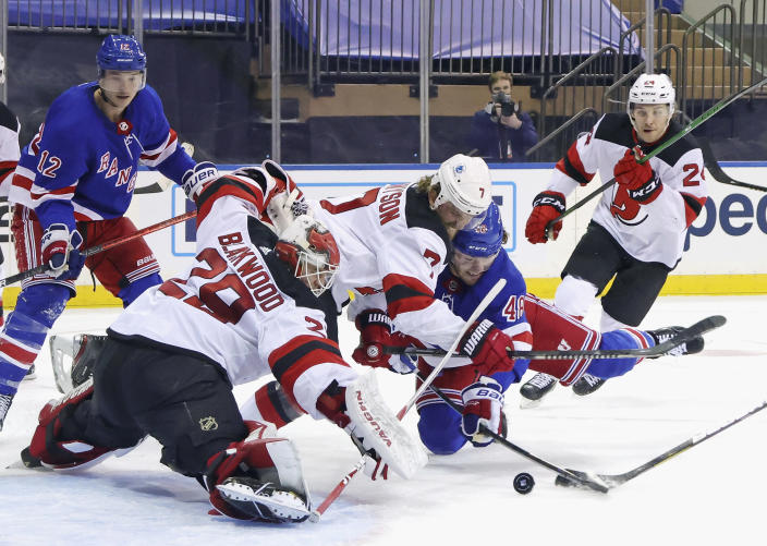 New Jersey Devils' Mackenzie Blackwood (29) and Matt Tennyson defend against New York Rangers' Brendan Lemieux, right, during the second period of an NHL hockey game Tuesday, Jan. 19, 2021, in New York. (Bruce Bennett/Pool Photo via AP)