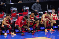 Atlanta Hawks' players watch from the bench during the final seconds of Game 2 in a second-round NBA basketball playoff series against the Philadelphia 76ers, Tuesday, June 8, 2021, in Philadelphia. (AP Photo/Matt Slocum)