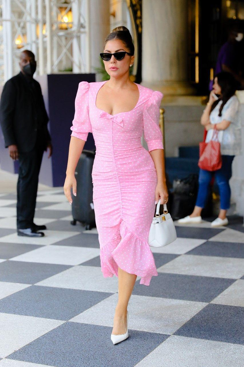 """<p>The 35-year-old superstar was a vision of old school Hollywood glamour while out in New York in this polka-dot, ruffle hem dress by Alessandra Rich. The current brunette paired the slightly puff-sleeved midi dress with a Fendi bag and cat-eye sunglasses.</p><p><a class=""""link rapid-noclick-resp"""" href=""""https://www.net-a-porter.com/en-gb/shop/designer/alessandra-rich"""" rel=""""nofollow noopener"""" target=""""_blank"""" data-ylk=""""slk:SHOP ALESSANDRA RICH NOW"""">SHOP ALESSANDRA RICH NOW</a></p>"""