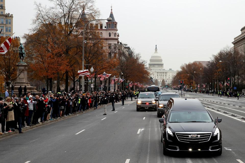 The hearse carrying the flag-draped casket of former President George H.W. Bush heads to a State Funeral at the National Cathedral, Wednesday, Dec. 5, 2018, in Washington. (Photo: Alex Brandon/Pool via Reuters)