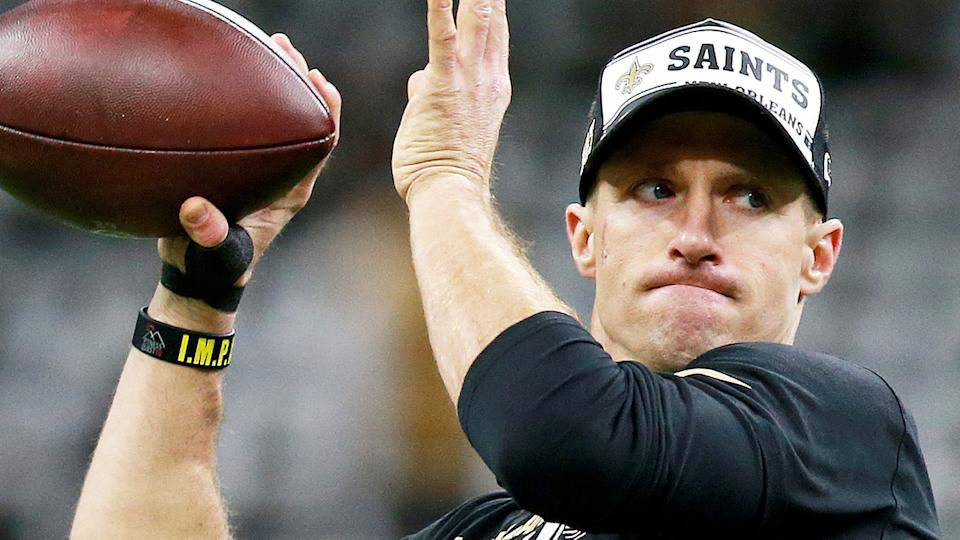 New Orleans Saints quarterback Drew Brees is pictured warming up before a game.
