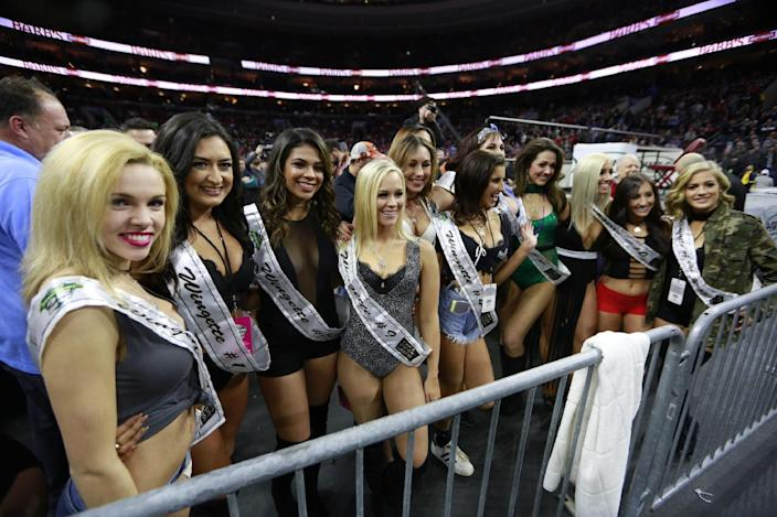 Wingettes parade at Wing Bowl on Friday, Feb. 3, 2017 in Philadelphia. The morning eating ordeal draws boozy spectators who tailgate beforehand outside the city's sports arena to watch flamboyant contestants. This year, rapper Coolio performed between rounds. (David Swanson/The Philadelphia Inquirer via AP)