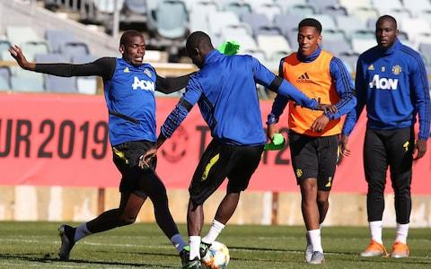 Paul Pogba (left) training with Manchester United - Credit: getty images