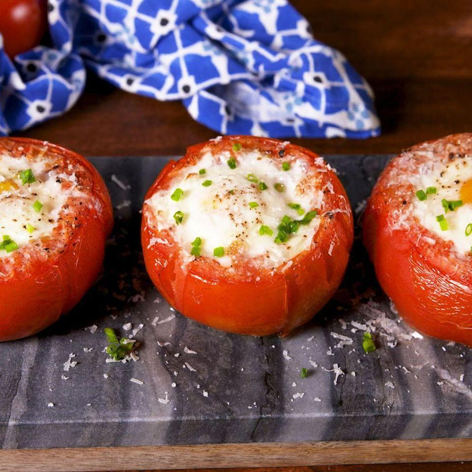 "<p>Not only do these tomato egg cups look adorable, but they taste amazing. These can be eaten on their own or incorporated into a larger breakfast menu. </p><p><em>Get the recipe at <a href=""https://www.delish.com/cooking/recipe-ideas/recipes/a58609/breakfast-tomatoes-recipe/"" rel=""nofollow noopener"" target=""_blank"" data-ylk=""slk:Delish"" class=""link rapid-noclick-resp"">Delish</a>.</em></p>"