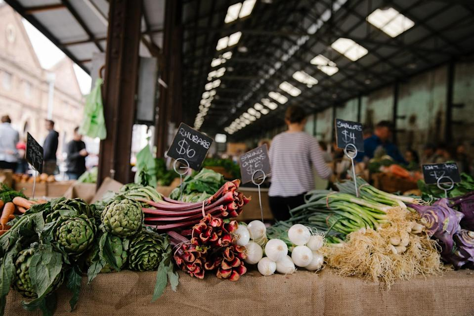 <p><strong>Let's start with scale. Where are we between global flagship and neighborhood boutique?</strong><br> One of Sydney's best produce markets, the weekly Carriageworks Farmers Market takes place every Saturday morning (8 a.m. to 1 p.m.). Free to enter, it's held in a cavernous, covered but open-air hanger in the historic former rail yards in Eveleigh, opposite Carriageworks arts center. It's a five-minute stroll here from Redfern Station along pretty Wilson Street; then turn left down the steps opposite Codrington Street. There is a wheelchair-accessible ramp and bike racks at street-level. If you're coming from Newtown, head down Carriageworks Way opposite Queen Street.</p> <p><strong>What can we find here, or what should we look for?</strong><br> Shop for seasonal, local produce at this respected farmers market, which hosts stalls by farmers and artisan producers from across New South Wales state. Organic and biodynamic food also stars, one of the passions of market creative director Mike McEnearney (chef of Sydney restaurant Kitchen by Mike). Think vibrant baskets of vegetables, fruit, meat, cheese, olives, tea, coffee, bread, preserves, and flowers.</p> <p><strong>If money's no object, what goes in the cart?</strong><br> Stalls change, but look out for tasty vegan sausages from Suzy Spoon's Vegetarian Butcher. You'll find top quality meats, truffles, and wine, too.</p> <p><strong>And … what if we're on a strict budget?</strong><br> Look out for free cooking demonstrations by top chefs, showcasing seasonal market offerings, and culinary workshops and classes. If the produce seems pricey, just pick up pastries or street food snacks to eat in the shaded table area outside, opposite the sunny wall of Carriageworks gallery. Favorites include crêpes and pho (Vietnamese noodles in broth). Seasonal markets and Night Market events keep things interesting. You can also enjoy coffee in Carriageworks arts venue across the way.</p> <p><strong>Who else shops here?</str