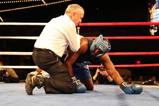 <p>Erin Fitchette is slow to get up as he assisted by the referree in the ring during a match against Mark Sinatra in the NYPD Boxing Championships at the Theater at Madison Square Garden on June 8, 2017. (Photo: Gordon Donovan/Yahoo News) </p>