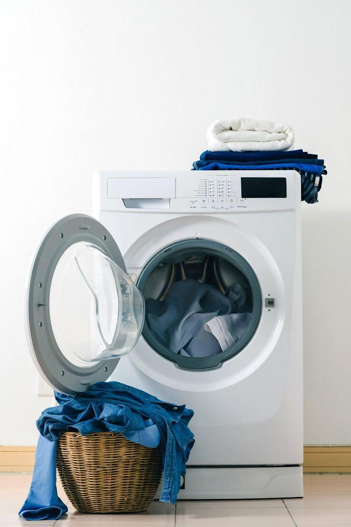 """<p>Just like your washing machine, your dryer needs regular cleanings as well. HGTV recommends <a href=""""https://www.hgtv.com/lifestyle/clean-and-organize/how-and-why-you-should-clean-your-dryer-today"""" rel=""""nofollow noopener"""" target=""""_blank"""" data-ylk=""""slk:wiping down your dryer drum"""" class=""""link rapid-noclick-resp"""">wiping down your dryer drum</a> using an even mix of white vinegar and water in a spray bottle and a microfiber cloth. </p><p>Make sure you also clean out the lint that's captured in the mesh screen of your lint trap. To do so, remove the lint trap and vacuum the area with a crevice attachment. Then, use a toothbrush dipped in warm, soapy water to clean the mesh. Allow the trap to dry completely before putting it back into the dryer. </p>"""