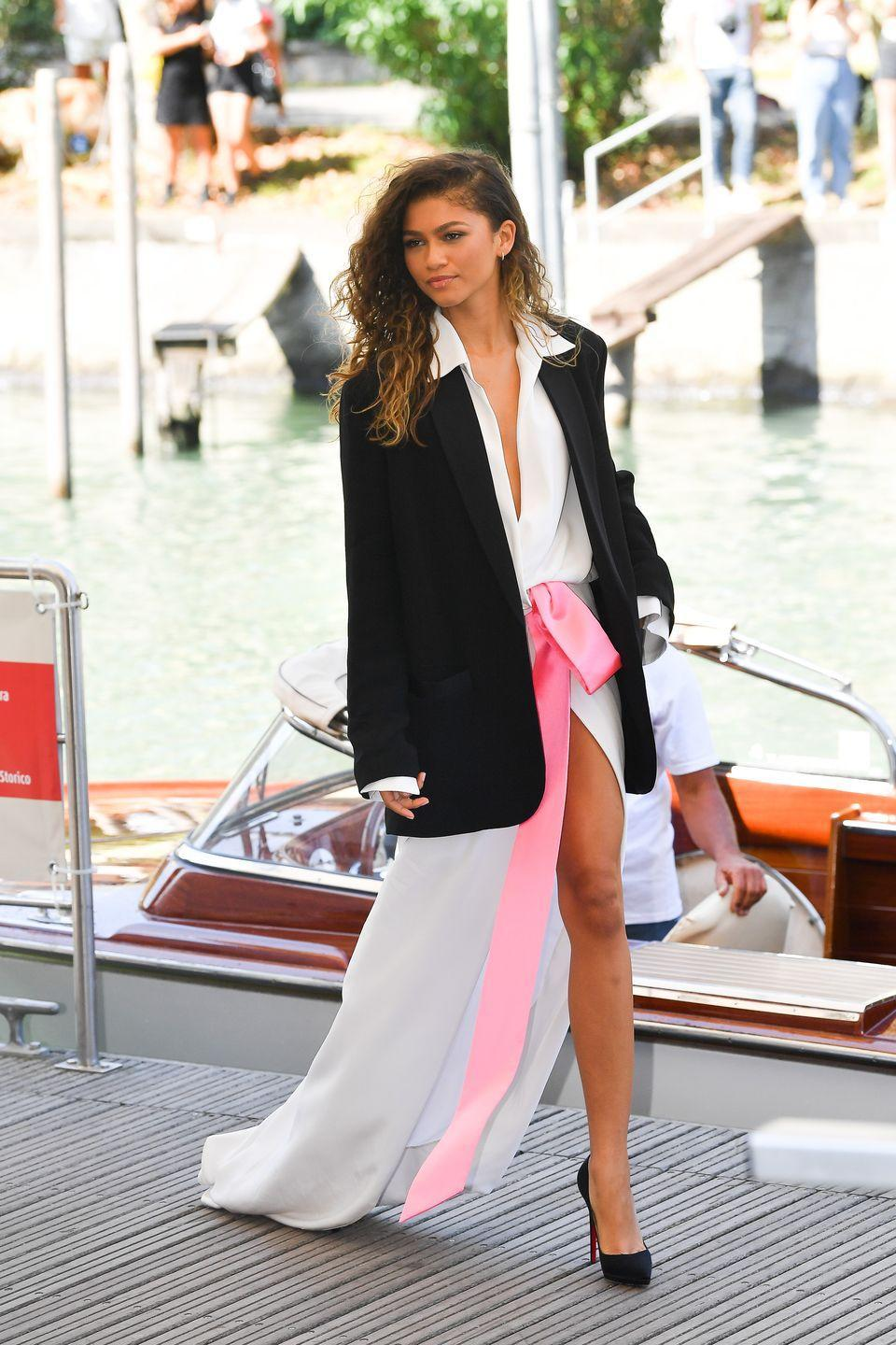 <p>Zendaya looked as chic and elegant as ever in a shirt dress with a pink satin bow around the waist which she teamed with an oversized black blazer.</p>