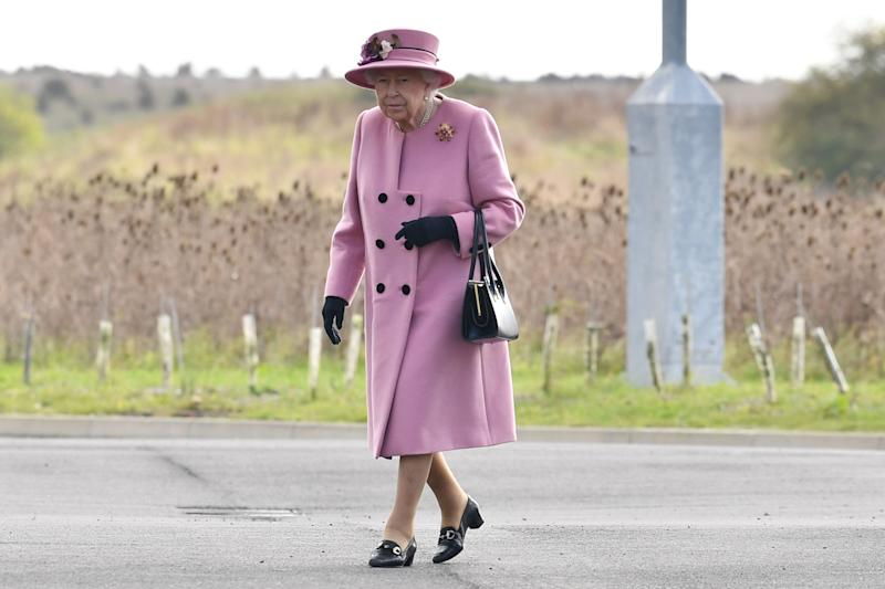 Britain's Queen Elizabeth II arrives at the Energetics Analysis Centre as they visit the Defence Science and Technology Laboratory (Dstl) at Porton Down science park near Salisbury, southern England, on October 15, 2020. - The Queen and the Duke of Cambridge visited the Defence Science and Technology Laboratory (Dstl) where they were to view displays of weaponry and tactics used in counter intelligence, a demonstration of a Forensic Explosives Investigation and meet staff who were involved in the Salisbury Novichok incident. Her Majesty and His Royal Highness also formally opened the new Energetics Analysis Centre. (Photo by Ben STANSALL / POOL / AFP) (Photo by BEN STANSALL/POOL/AFP via Getty Images)